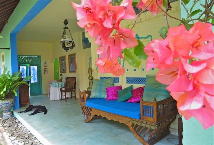 Bougainvillaea and passionfruit vine frame Pondok Lili's open living area