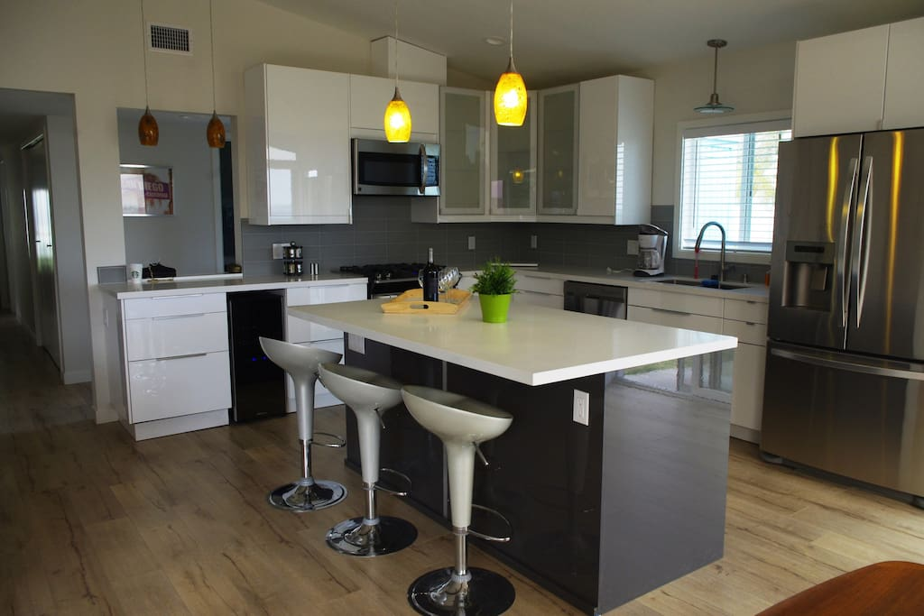 Newly remodeled kitchen with open floor plan, island kitchen and panoramic views.