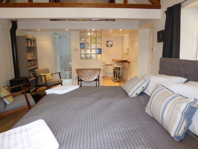 The open plan bedroom and sitting area