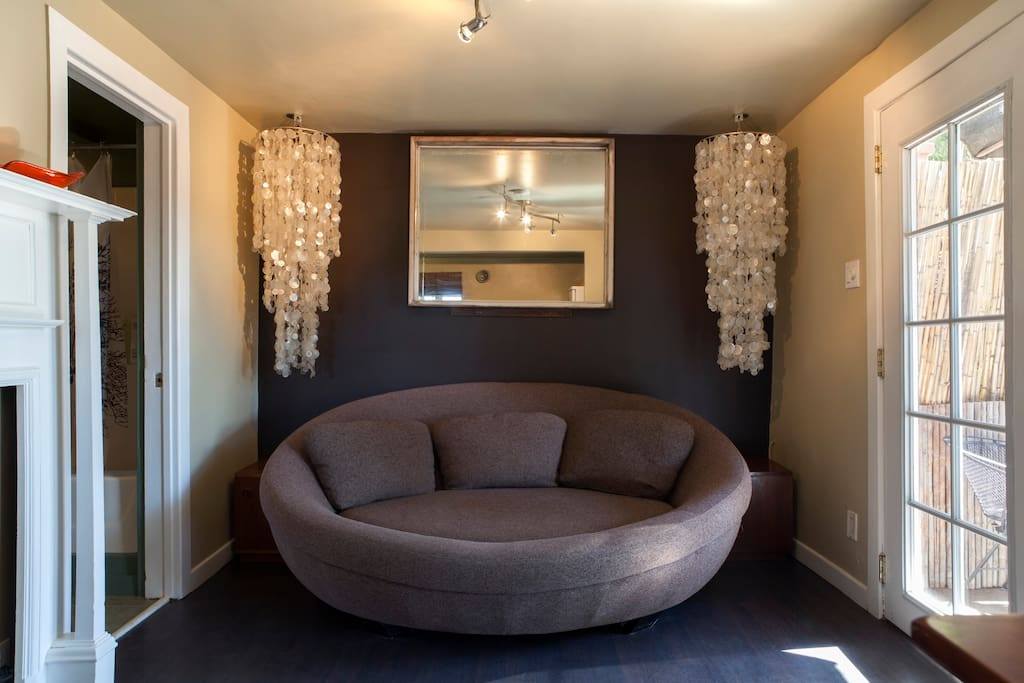 Flanked by a pair of chandeliers, fall into the UFO Sofa where you will be consumed by comfort!