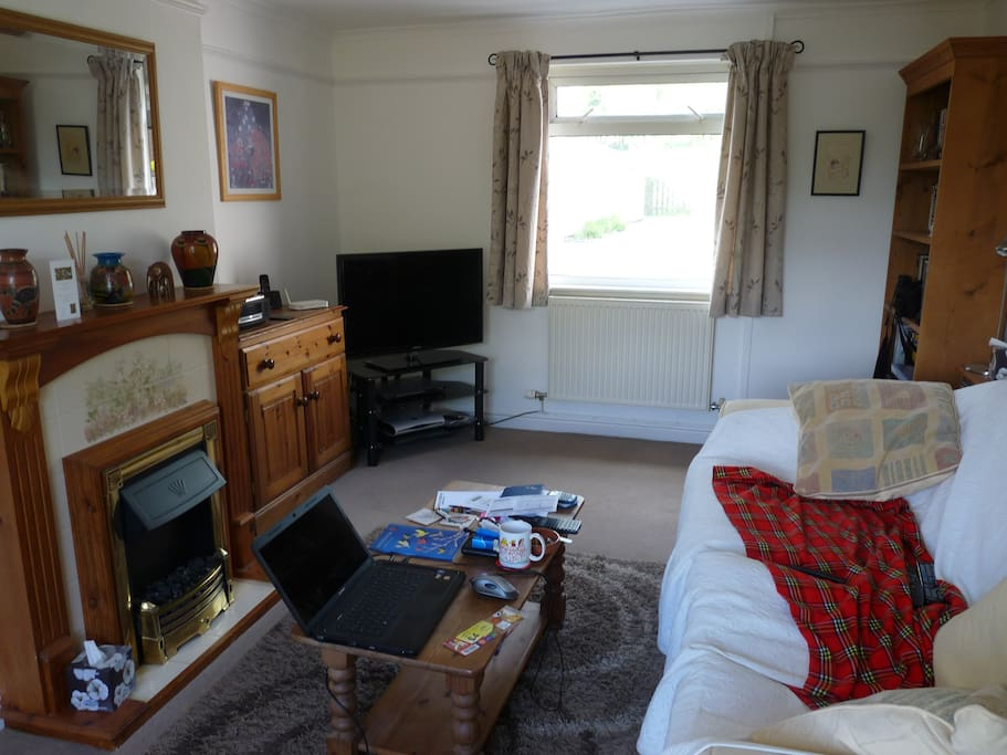 The living room is double aspect, with use of TV and Bose sound system.