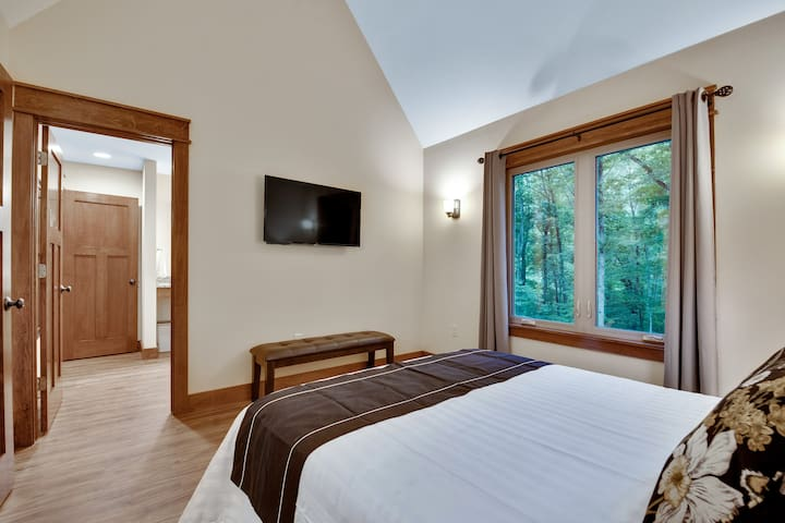 Bedroom with views of the forest and access to bath