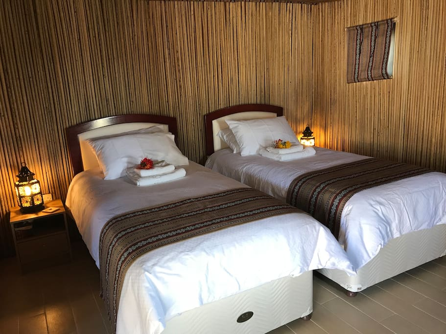 Relax in the comfort and seclusion of our Neem twin cabin
