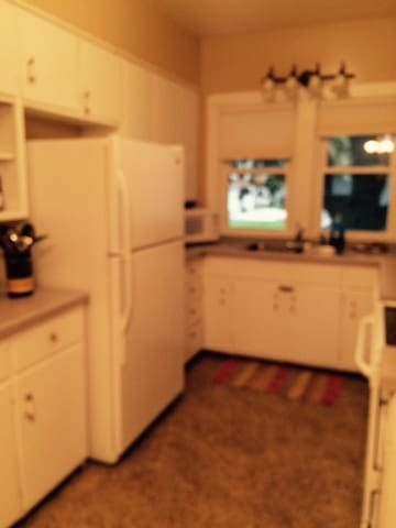 Main floor kitchen,  Ice maker in the refrigerator, dishwasher, glass top electric stove, coffee makers, microwave, toaster.