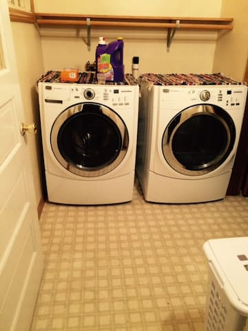 Main floor laundry area.  Ironing board and iron are stored in this area as well.