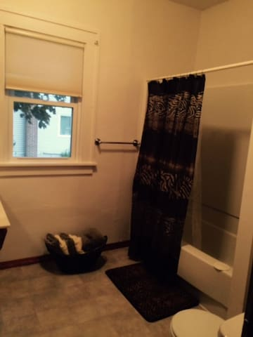 One of two main floor bathrooms, tub/shower combination.