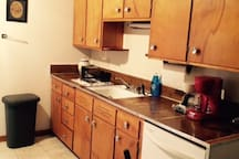 Upstairs kitchen and dining area includes dishwasher, stove and refrigerator.