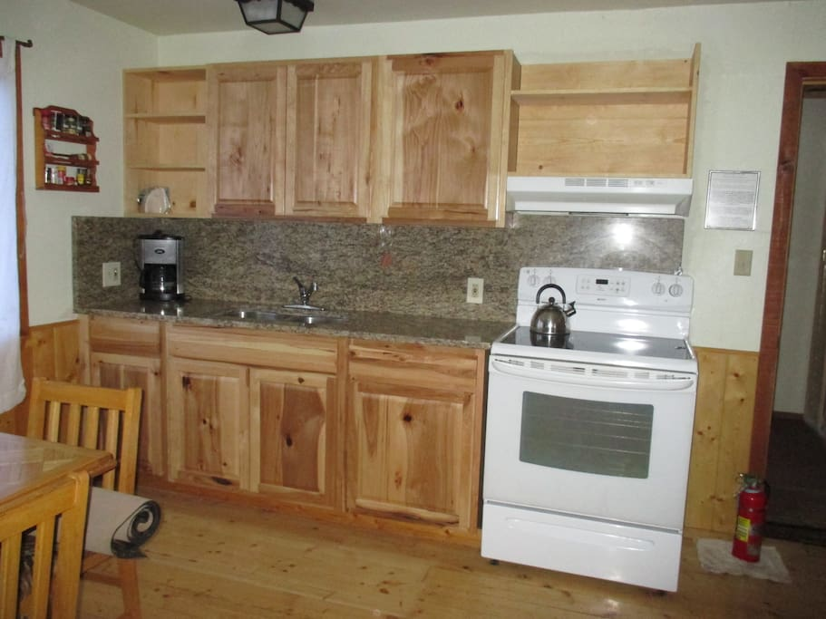 brand new kitchen with granite counter