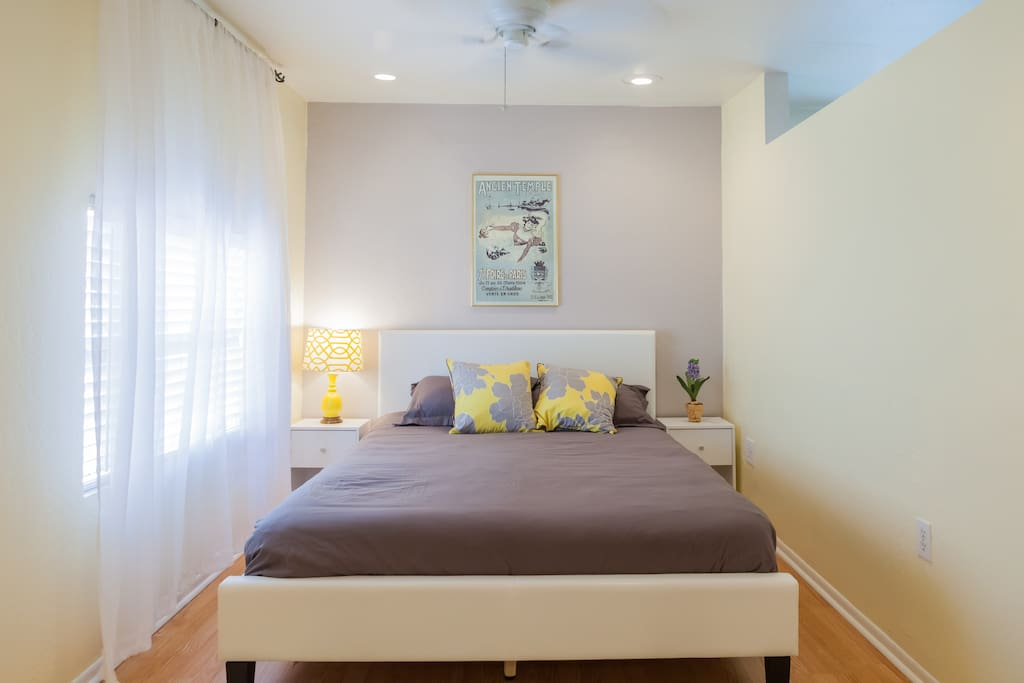 Queen bed with high quality linens. This room is quite big as it extends several feet past the edge of the bed and accommodates a large closet & an ensuite bathroom.