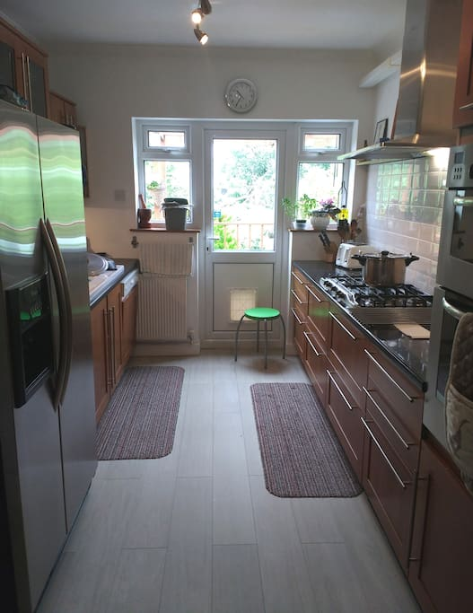 The kitchen with access to the veranda