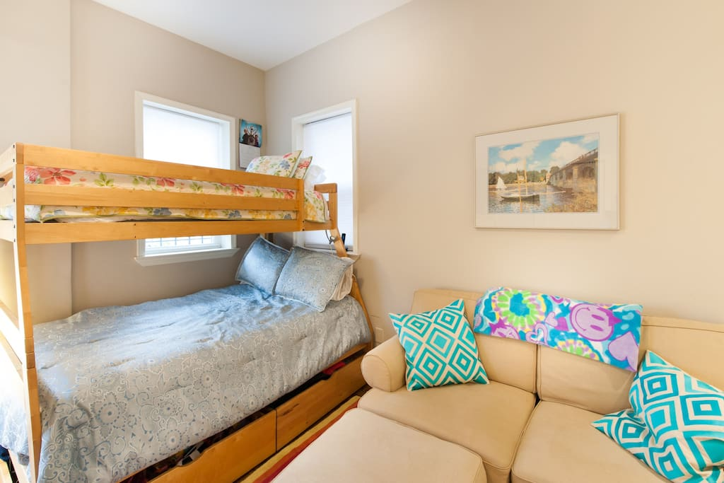 Bunk bed is a full bed on the bottom and twin on the top. A full-height twin airbed is available on request.