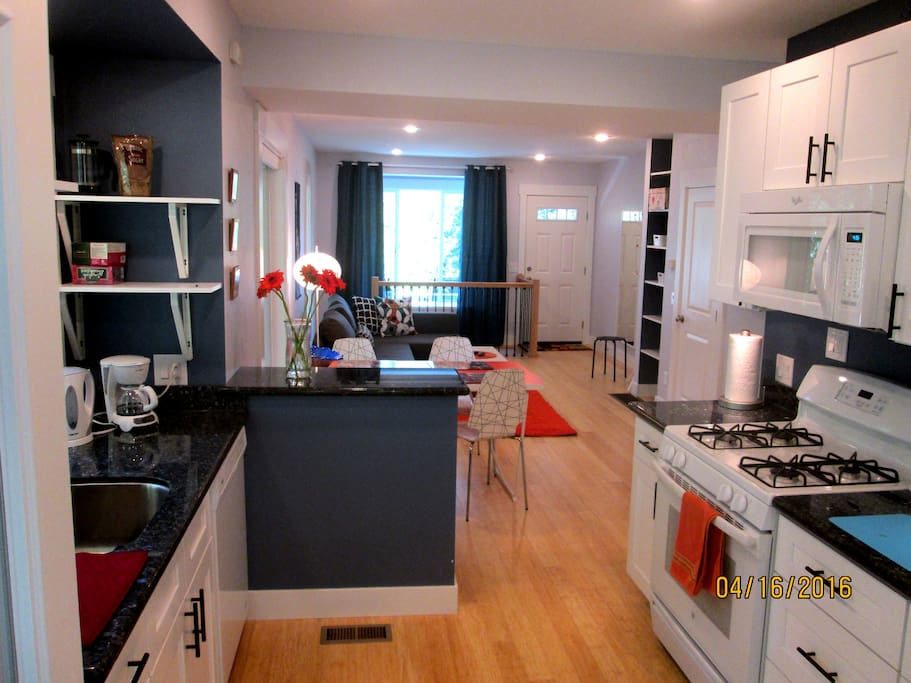 Open floor plan with combined kitchen, living and dining