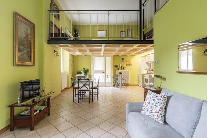 Cozy open space with loft in Como center