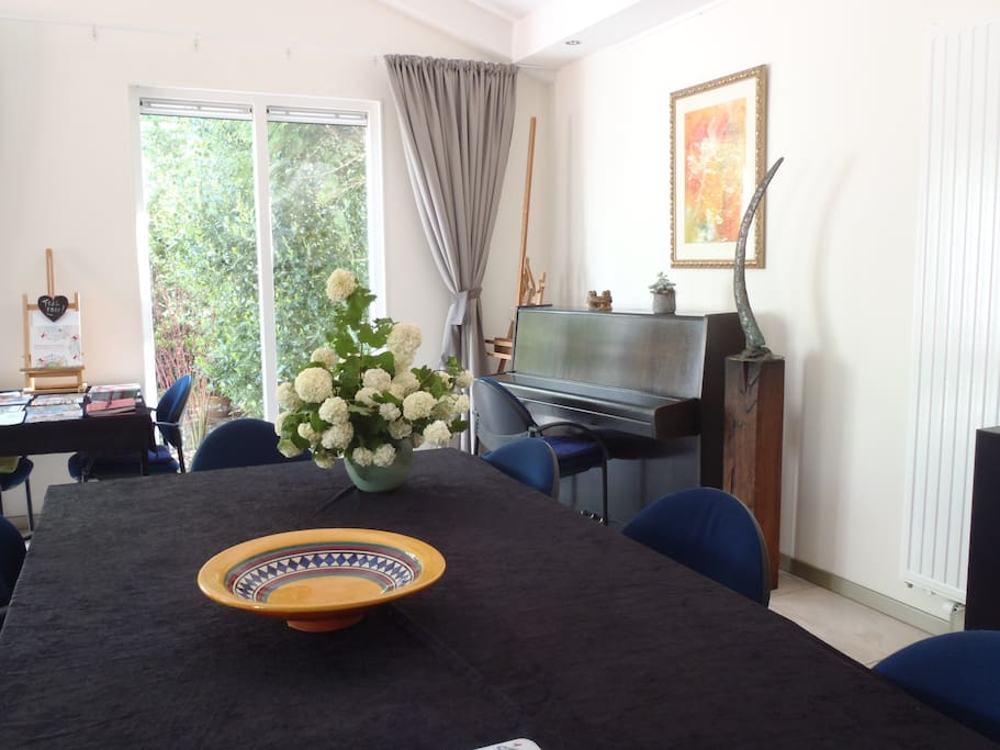 The livingroom with the piano and flowers from our garden