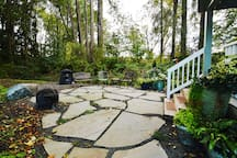 Inviting stone patio complete with all weather seating, fire ring and gas grill.