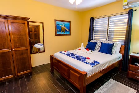 Bedroom with Queen bed and Air Conditioner