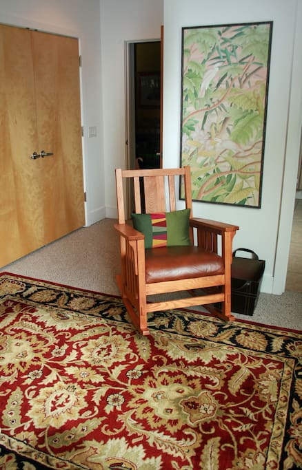 Comfortable Rocking Chair and Spacious Closet.