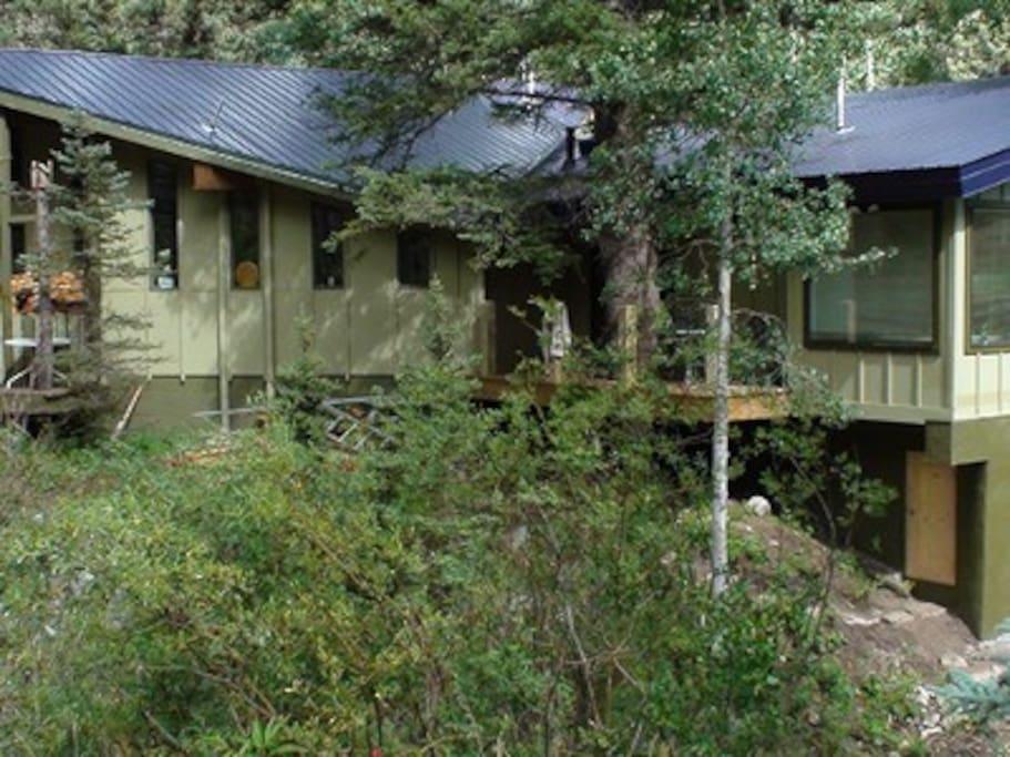 Backside of Chalet house along the Rio Hondo river