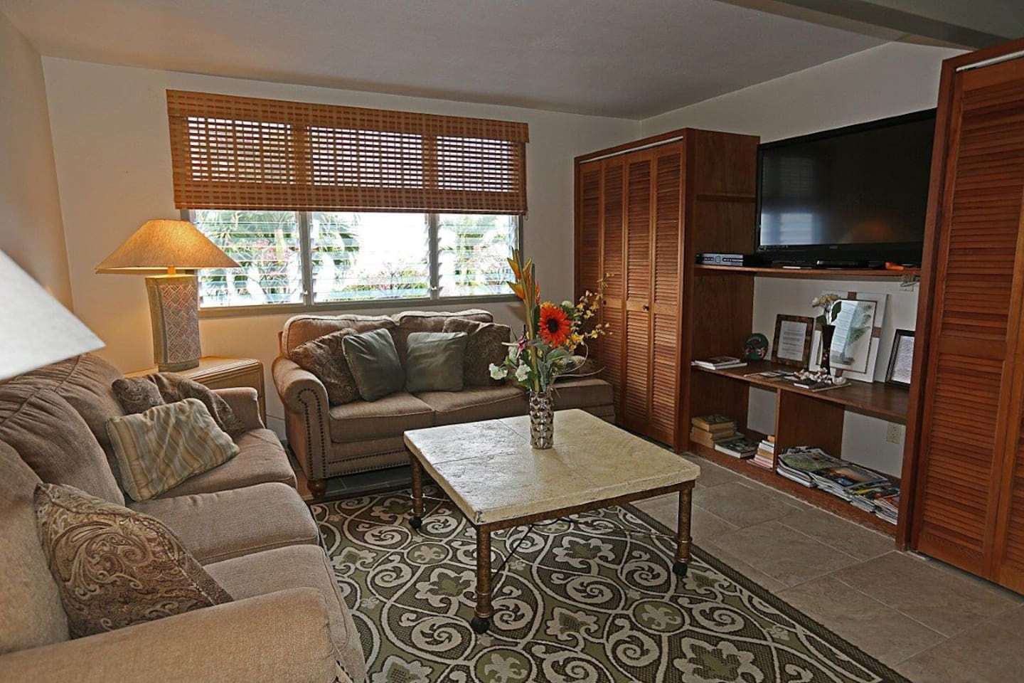 Very comfortable living room with ocean view and 42 in HDTV!