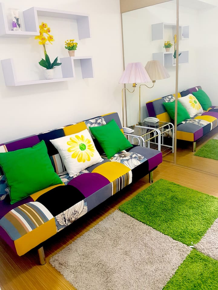 Living Room with BR divider with mirrors
