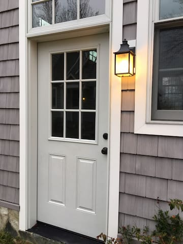 Separate entrance with lighting and security lights.