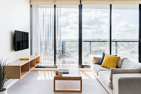 Enjoy City Views from the Balcony of a Chic Apartment