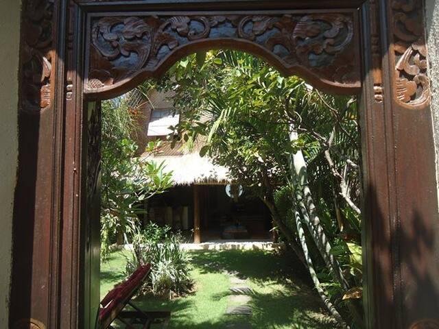 the entry door to go inside the villa
