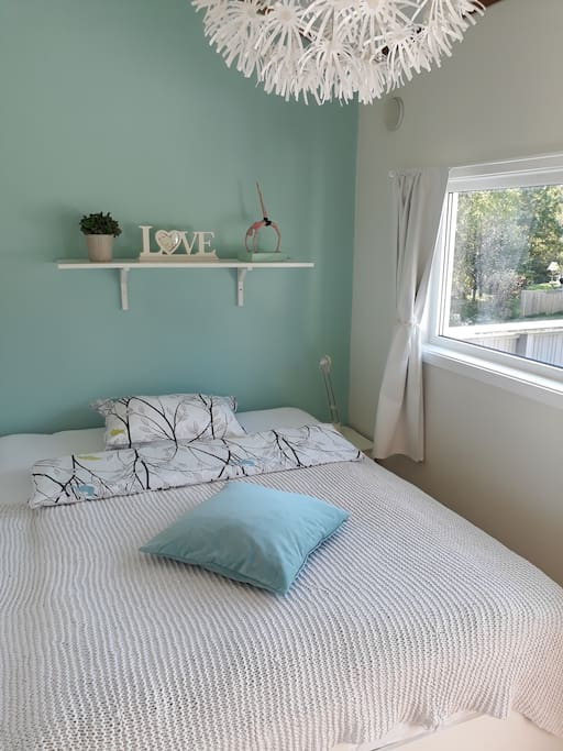 """Double bed in very bright room """"Air"""" with private southwest balcony."""