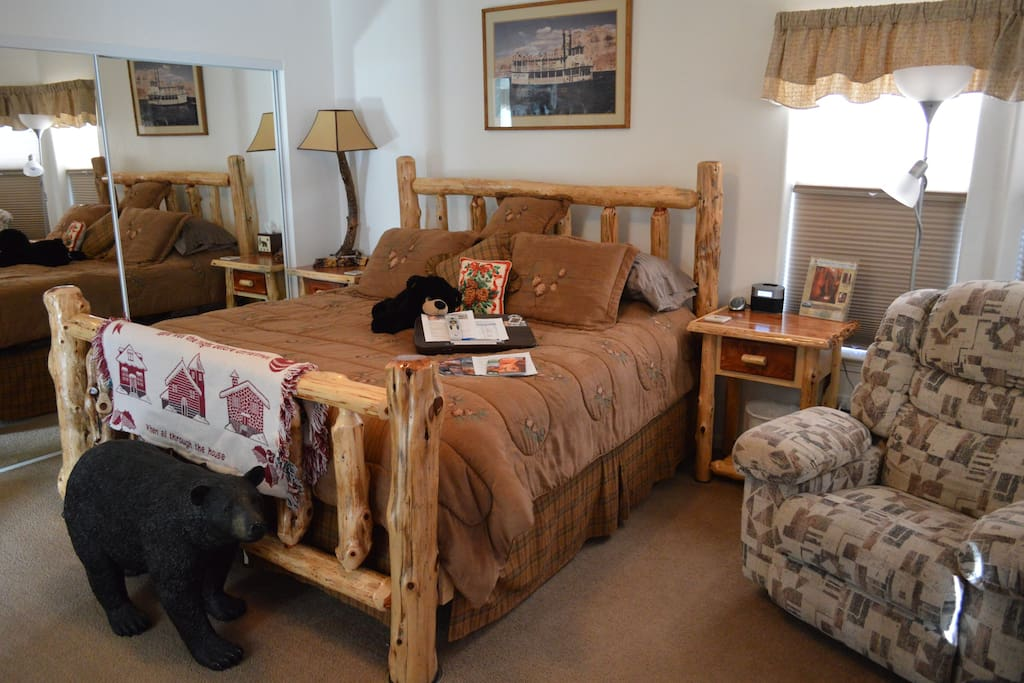 Our King 1 Room with cabin style bed decor.  A spacious 210 Sq. Ft. is a great way to relax in comfort.