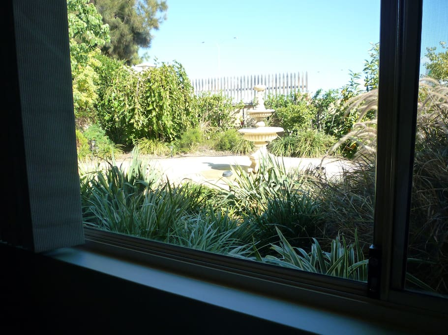 FROM YOUR BEDROOM, LOOK OUT ONTO A PRETTY AND TRANQUIL GARDEN