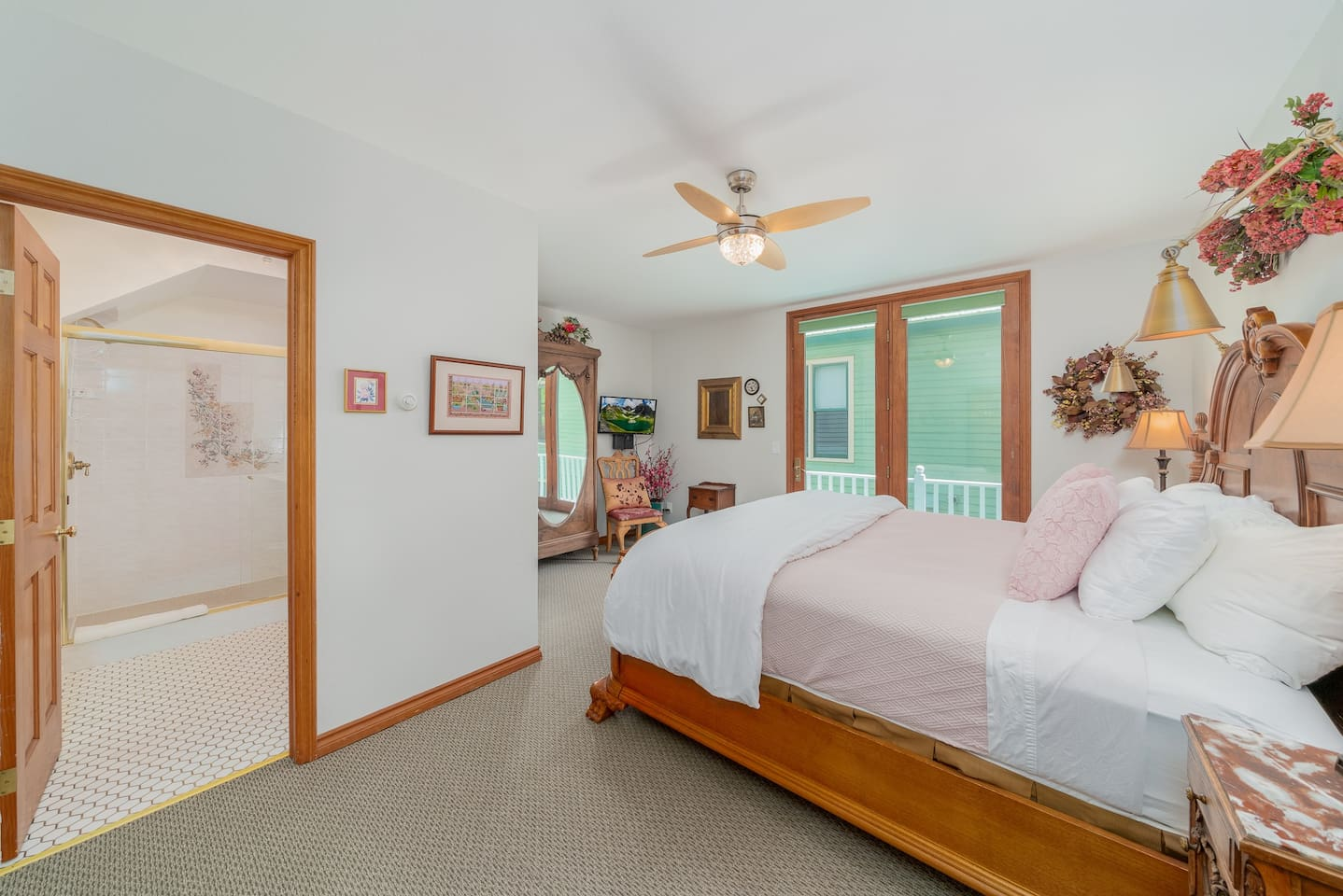 King sized bed with crisp linens. Private balcony, ceiling fan and radiant floor heat