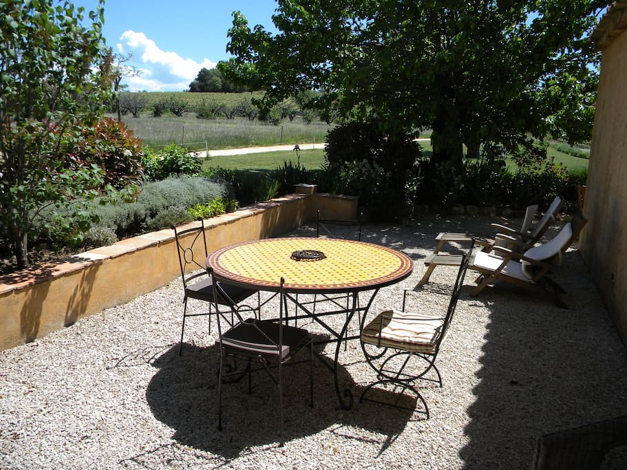 Your private terrace with view of the countryside and the village of Saint Saturnin.