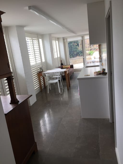 Front entrance at end of photo adjoins outside sitting space that you can use below swimming pool.  Whole apartment in French stone with underfloor heating.