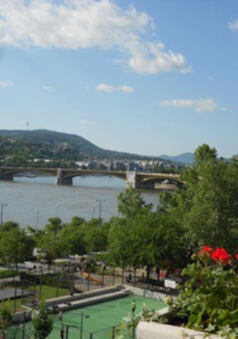 Your view from the balcony of the Danube River and Margit Bridge.