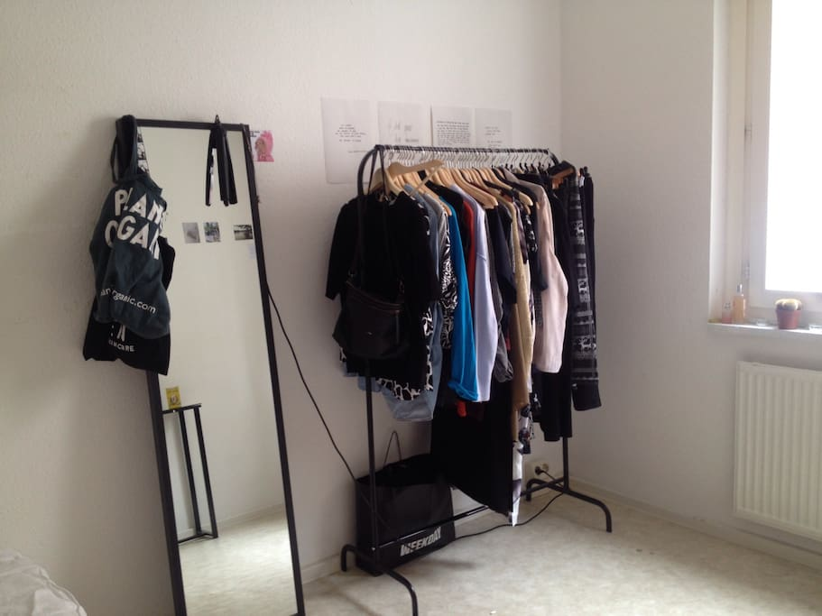 Clothing rack, quotes, and shopping bags