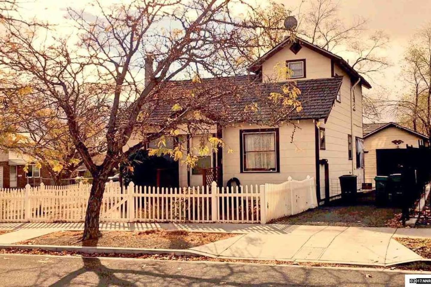 A charming cottage with a white picket fence.