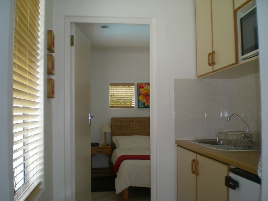 Kitchenette leading into the bedroom