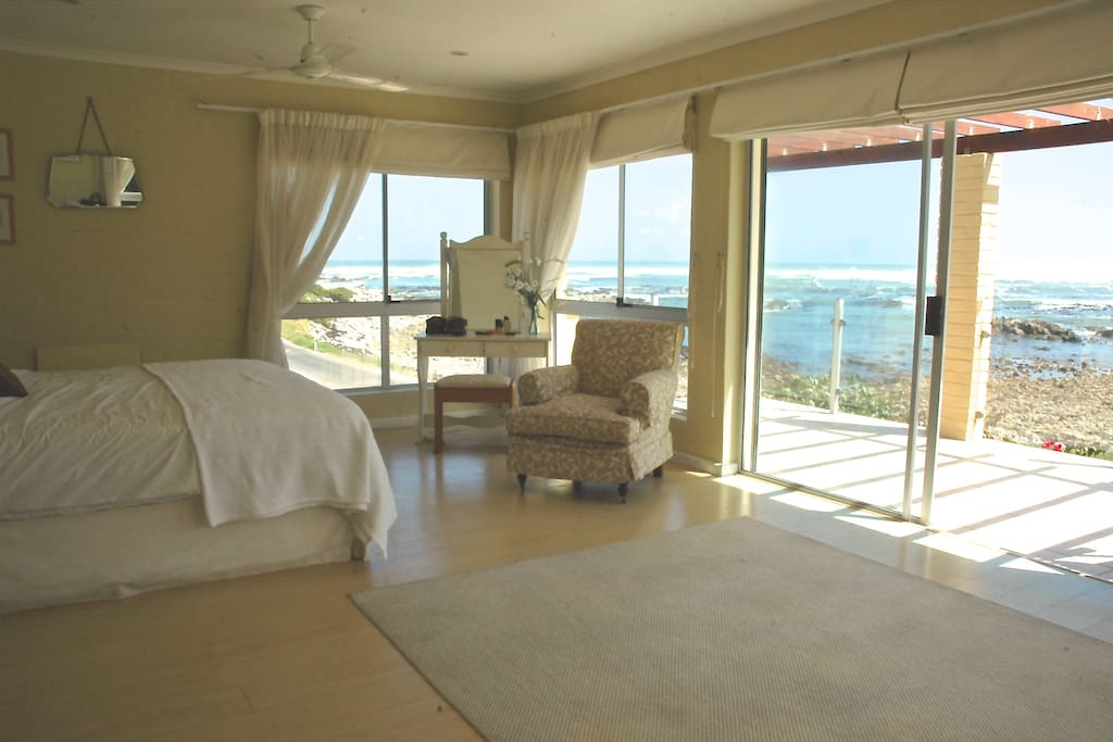 Main ensuite double bedroom with balcony and sea views