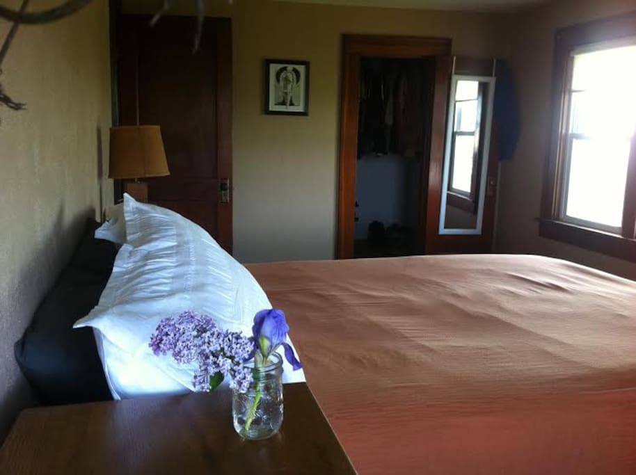 Master room, upper level. Awesome light and original woodwork.