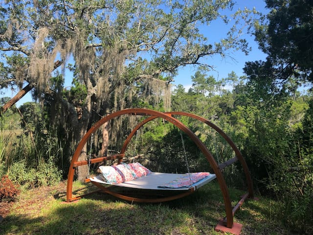Swinging Bed in the breeze on the marsh