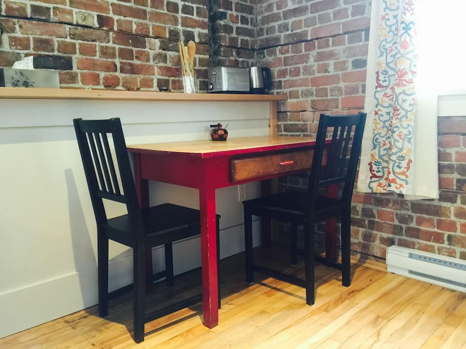 Room for two at the cozy red schooldesk-turned-table.