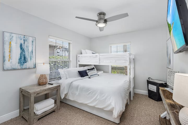 Guest bedroom with king size bed, a twin bed (bunk style) and a pull out trundle twin size bed, ideal for a little one! A large closet for storage and smart TV.