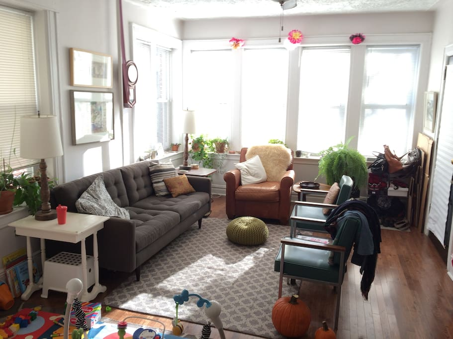 Sunny living room adjoins newly renovated kitchen