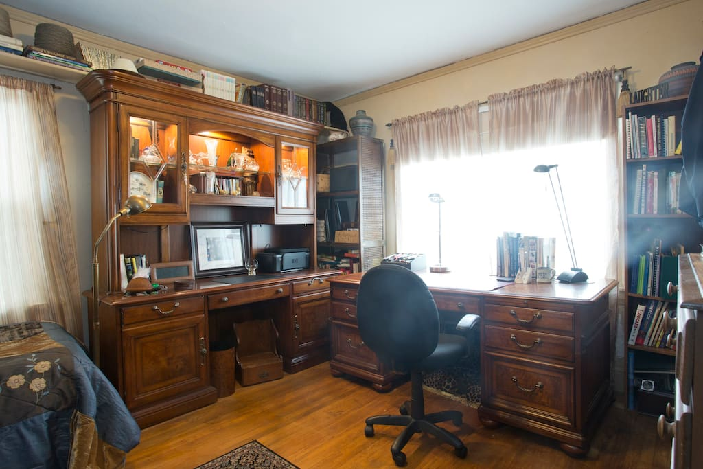 The two executive desks in the upstairs bedroom make working a pleasure.