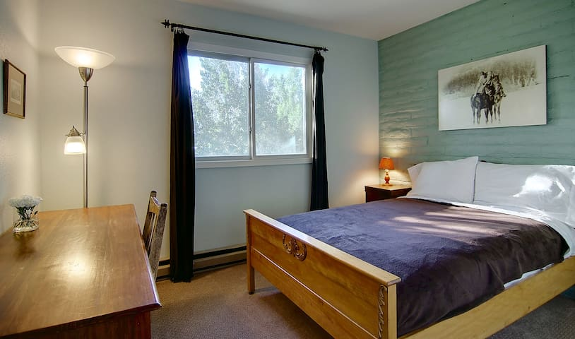 Full Bed in Green Bedroom