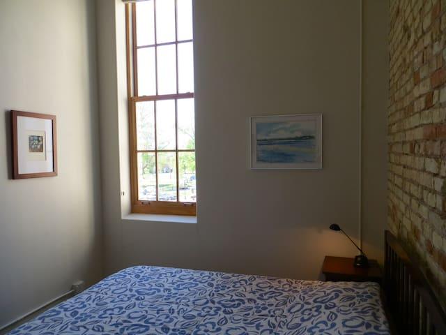 8 ft. window in bedroom. queen sized memory foam bed.