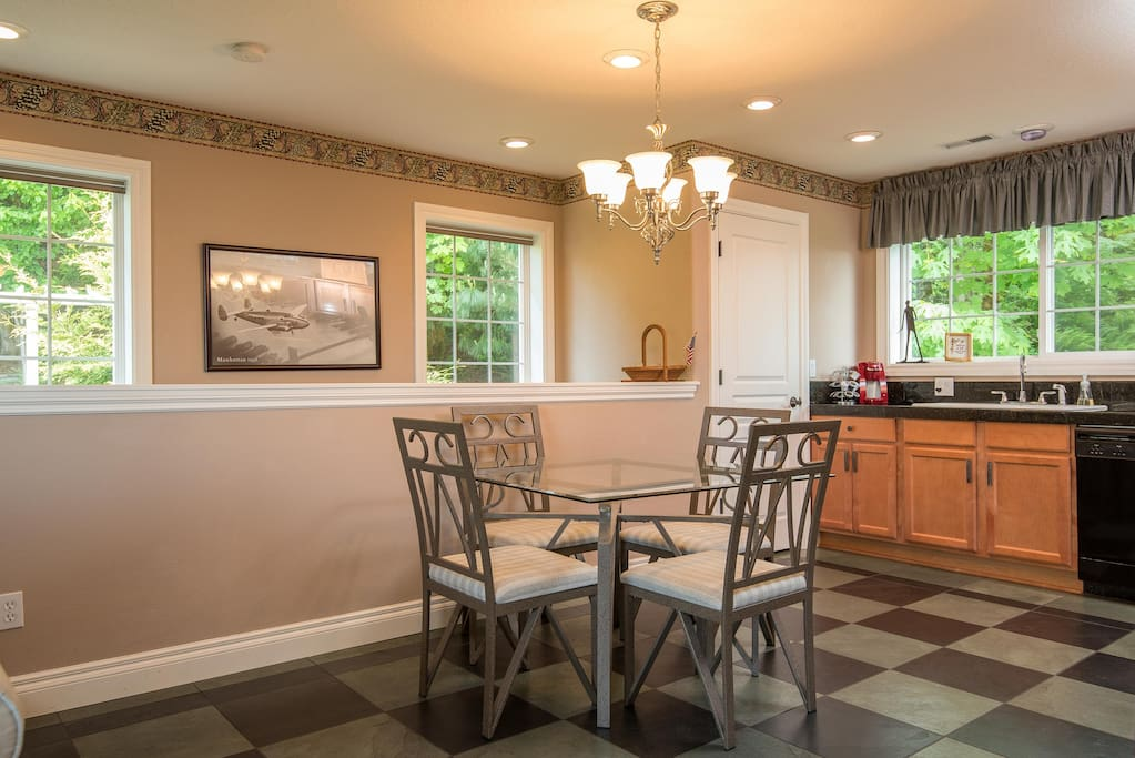 Beautiful dinning/Kitchen with plenty of cabinetry, over-sized slate tile floors, appliances, gas range, microwave and walk-in pantry.