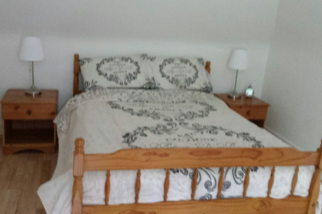 Main bedroom with lovely outlook; double bed, bedside tables and lamps, wardrobe and chest of drawers