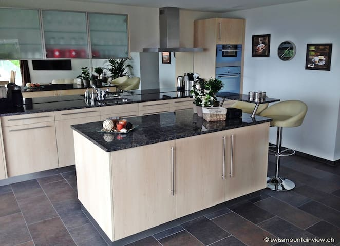 Luxury kitchen with dishwasher, oven, microwave, fridge, freezer and all gadgets one my need to feel like in your own kitchen ...of course also with a Fondue and Raclette set.