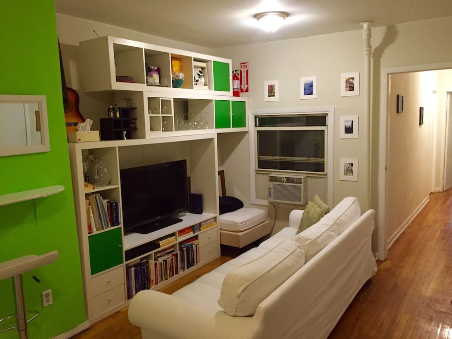 Living room with DVD player, Netflix, and Hulu Plus. Counter space for eating or working on